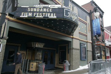A festival worker takes a break under the marquee promoting the 2008 Sundance Film Festival