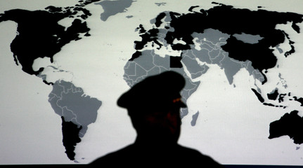 A police officer attends the opening ceremony of the Global Initiative to Combat Nuclear Terrorism conference in Miami