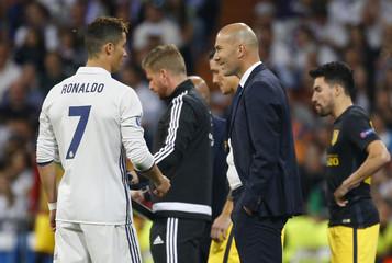 Real Madrid's Cristiano Ronaldo and Real Madrid coach Zinedine Zidane