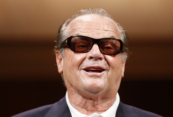 """Actor Nicholson smiles after a news conference to promote his movie """"The Bucket List"""" in Tokyo"""
