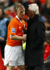 Netherlands' van Mafrwijk thanks Kuyt as he is substituted against Macedonia during their 2010 World Cup qualifying soccer match in the Amsterdam