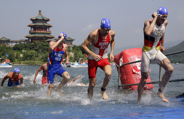 Competitors race during the men's triathlon competition at the Ming Tomb reservoir in the Changping District of northern Beijing during the Beijing 2008 Olympic Games