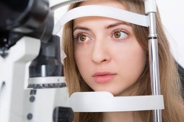 young woman during eyes examination