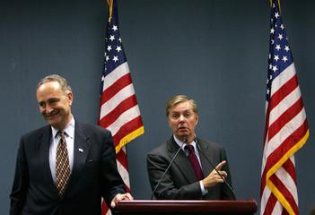 US senator Graham speaks as US senator Schumer stands near him at news conference in Beijing