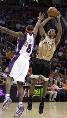 Washington Wizards Nick Young shoots while being guarded by Phoenix Suns D.J. Strawberry during first quarter of NBA game in Phoenix