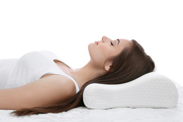 Young woman sleeping on bed with orthopedic pillow against white background. Healthy posture concept