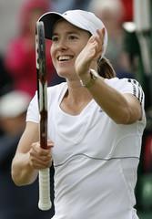 Belgium's Henin gestures after winning her quarter finals match at the Wimbledon tennis championships in London
