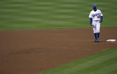 Los Angeles Dodgers' Juan Pierre waits on second base during the second inning of their National League baseball game against the San Diego Padres in Los Angeles