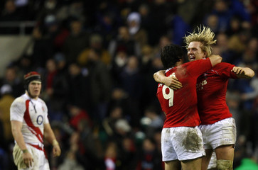 Popham and Phillips and Wales celebrate defeating England during their Six Nations international rugby match at Twickenham in London