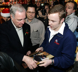 Paul Martin autographs a photo for a supporter in Windsor