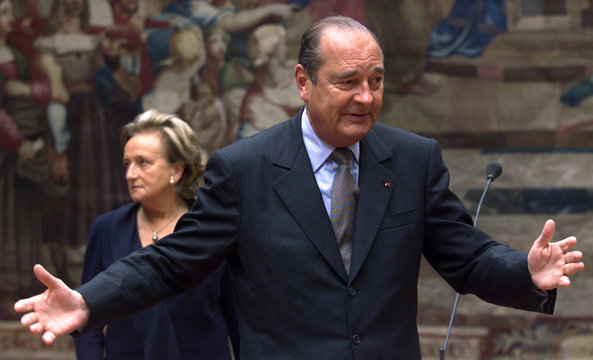 French President Jacques Chirac gestures during  Lilly of the Valley traditionnal ceremony while his..