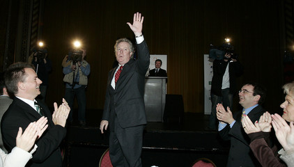 Quebec Premier Charest acknowledges applause during campaign stop in Sherbrooke