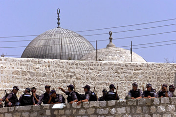 Israeli border police reinforce the area around  al-Aqsa Mosque (gray dome in background) during Fri..