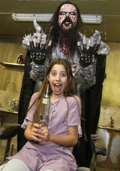 "British actress Skye Bennett and Finnish musician Tomi Petteri Putaansuu, dresses as his character of ""Mr Lordi"", pose on the set of the horror movie ""Dark Floors"" in Oulu"