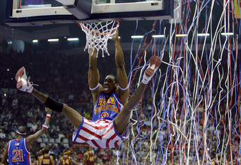 Anthony Greenup of Harlem Globetrotters slams dunk during game with NY Nationals in Istanbul