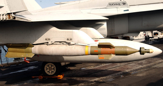 LASER GUIDED 500 LB BOMB ABOARD THE AIRCRAFT CARRIER ABRAHAM LINCOLN.