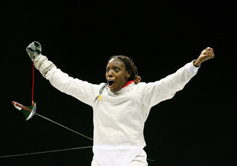 Cuba's Faez celebrates after winning the gold medal against the U.S. in the women's team sabre fencing competition at the Pan American Games in Rio de Janeiro