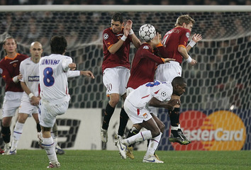 Lyon's Juninho shots a free kick against AS Roma during his Champions League first knockout stage, first leg soccer match at the Olympic stadium in Rome