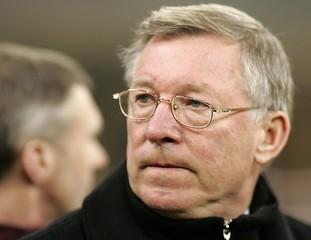 Manchester United's manager Ferguson looks away during their Champions League first round knockout ...