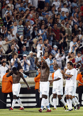 Olympique Marseille's players acknowledge their supporters after their French Ligue 1 soccer match against Stade Rennes in Marseille