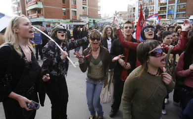 Kosovo Serb women sing and dance during a protest in the ethnically divided town of Mitrovica