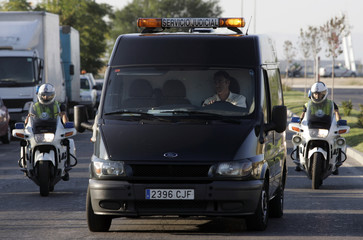 Funerary vehicles escorted by Spanish police arrive to deliver bodies of dead passengers at Madrid's IFEMA fairgrounds