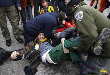 Israeli police arrest demonstrators during a sit-in demonstration in Jerusalem