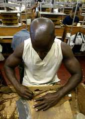 - PHOTO TAKEN 04FEB04 -A Cuban torcedor or cigar roller, uses a high quality tobacco leave to wrap a..