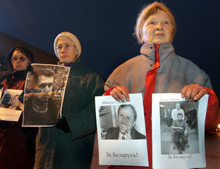 Belarus protesters hold portraits of opposition leaders detained by police during demonstrations ...