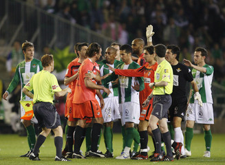 Sevilla and Real Betis players scuffle during their Spanish King's Cup soccer match at Manuel Ruiz de Lopera stadium in Seville