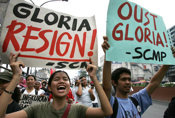 Filipino students display placards calling for the ouster of Philippine President Gloria Macapagal Arroyo weeks after the lifting of a national state of emergency during a protest in Manila