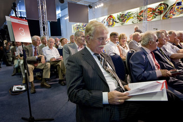 People attend a shareholders meeting at the Dutch Fortis headquarters in Utrecht