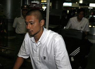Japan's Keisuke  arrives at the Noi Bai airport in Hanoi