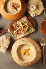 Delicious cream soup in bread on table