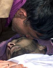 A KASHMIRI MUSLIM KISSES THE BODY OF A CIVILIAN KILLED IN NARBAL.