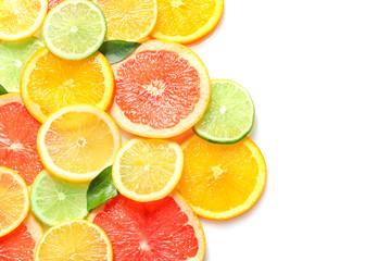 Fresh slices of citrus fruits on white background Fototapete