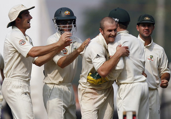 Australia's Krejza celebrates with team mates after taking wickets of India's Laxman during their fourth test cricket match in Nagpur