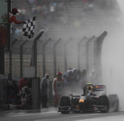 Red Bull Formula One driver Sebastian Vettel of Germany crosses the finish line to win the Chinese F1 Grand Prix in Shanghai