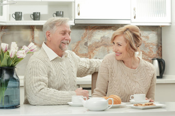 Cute elderly couple in kitchen
