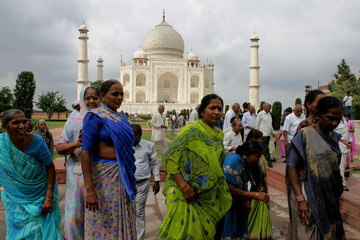 Tourists visit the Taj Mahal in the tourist city of Agra.