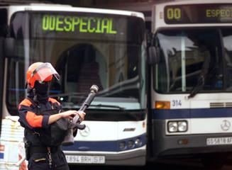 BASQUE POLICEMAN GUARDS SAN SEBASTIAN'S BUS STATION.