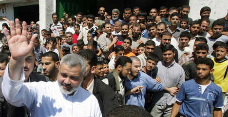 Palestinian PM Haniyeh waves after the Friday prayers in Gaza