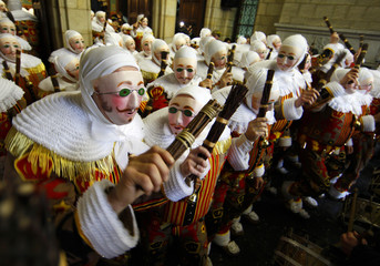 Participants perform Gilles of Binche dance during carnival in Binche