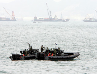 Hong Kong policemen on boats patrol near venue for World Trade Organisation meeting in Hong Kong
