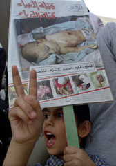 Fareh, a seven-year-old Jordanian girl holds a picture of the slain four month-old Palestinian baby ..