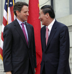 Treasury Secretary Timothy Geithner and Chinese Vice Premier Wang Qishan arrive at the Economic Track Opening Session