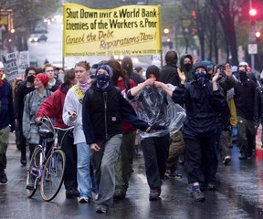 DEMONSTRATORS MARCH IN THE STREETS OF WASHINGTON.