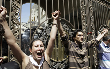 Opposition coalition supporters shout during a rally in central Tbilisi