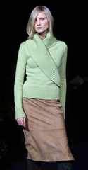 MODEL WEARS LIME SWEATER AT HERRERA FASHIONS.