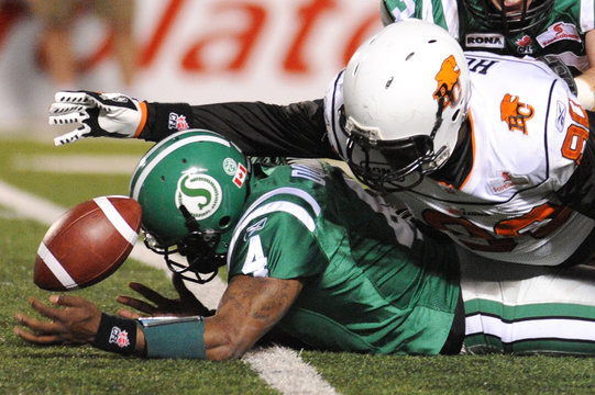 Saskatchewan Roughriders quarterback Durant is sacked by British Columbia Lions Hunt